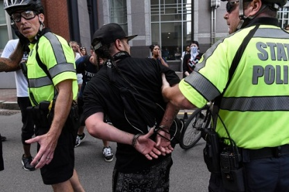 A counter protester is detained by Boston Police outside of the Boston Commons and the Boston Free Speech Rally in Boston, Massachusetts